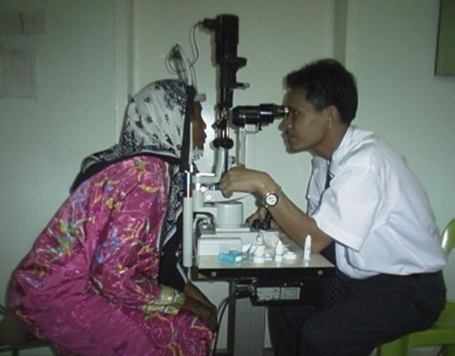 MA Awang examining a patient on the slit lamp
